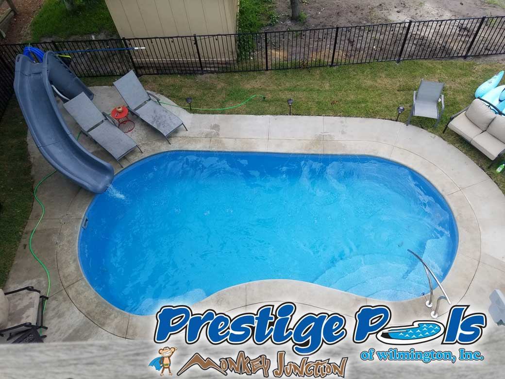 Wilmington NC pool with custom concrete decking